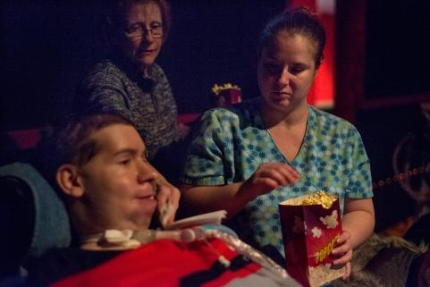 Nurse Erin feeds Dustin popcorn